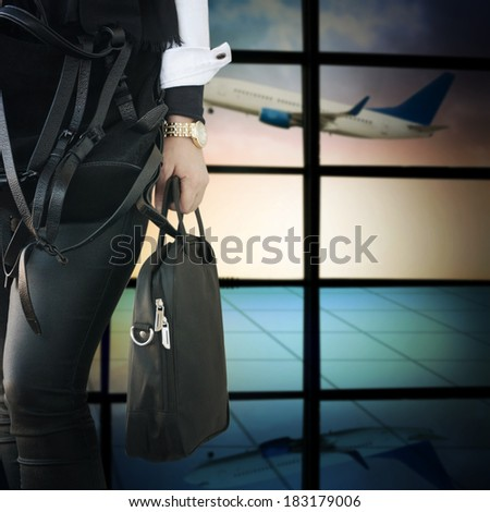 Woman with notebook bag in the airport