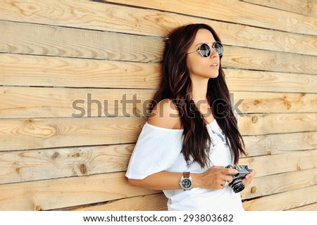 Woman with old camera - outdoor  - stock photo