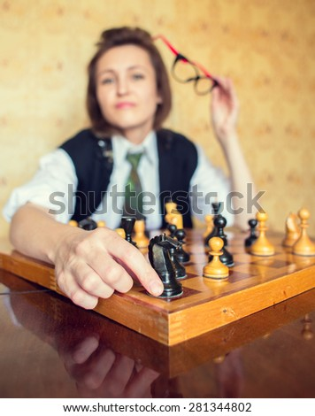 woman with old chess - stock photo