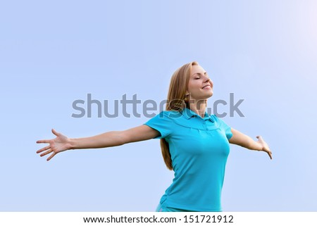 Woman with open arms and enjoying freedom