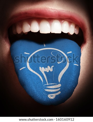 woman with open mouth spreading tongue colored in blue and lightbulb as concept - stock photo