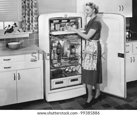 Woman with open refrigerator - stock photo