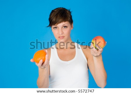 woman with orange and apple