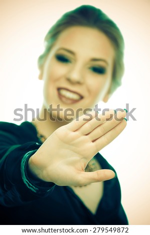 Woman with outstretched palm (for your text) in front of her - stock photo