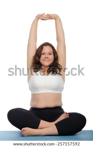 woman with overweight involved in fitness on blue mat - stock photo