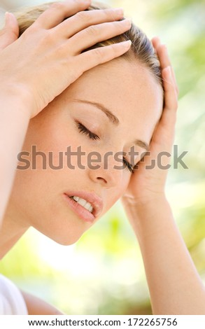 Woman with pain - stock photo
