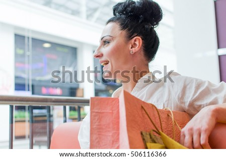 Woman with paper bags in the shopping mall