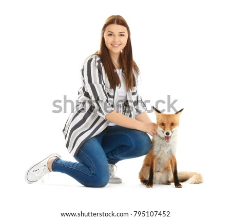 Woman with pet fox on white background