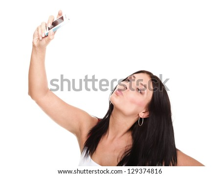 woman with phone isolated Young happy attractive female in red dress takes photos using her mobile phone isolated