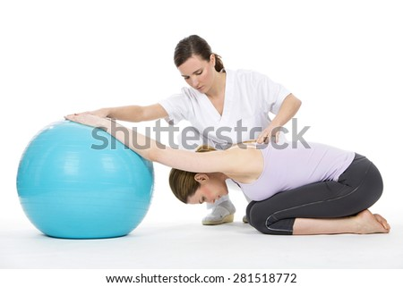 woman with physiotherapist exercising and reinforcing the vertebral column - stock photo