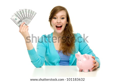 Woman with piggy bank and dollar bills - stock photo