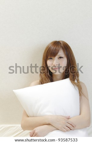 Woman with pillow.