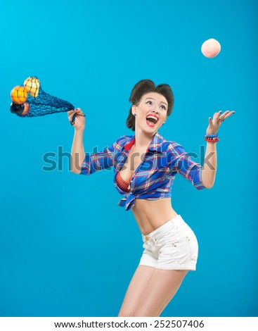 woman with pin-up make-up with a bag of fruit - stock photo
