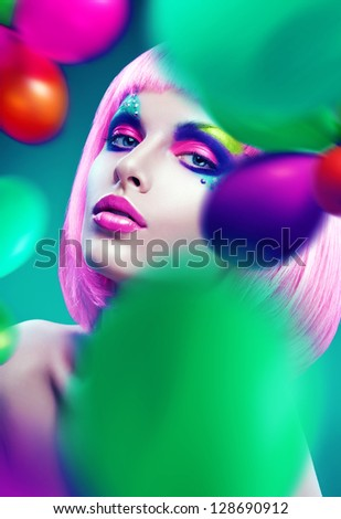 woman with pink hair and colourful balloons - stock photo