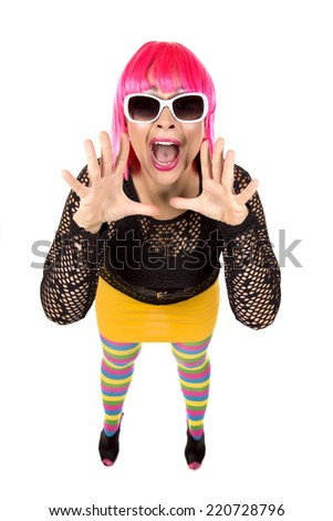 woman with pink hair wearing colorful stylish outfit
