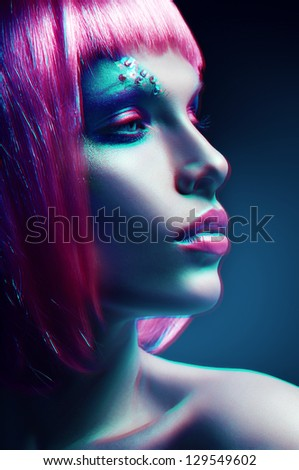 woman with pink hairstyle in motion - stock photo