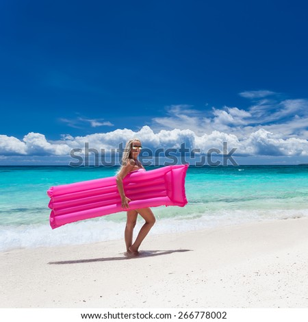Woman with pink swimming mattress on tropical beach, Philippines, Boracay  - stock photo