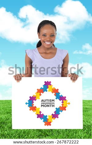 Woman with placeholder in her hands on white background against field and sky - stock photo