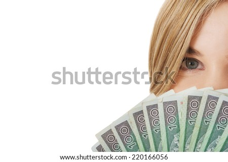 Woman with polish money in hand - stock photo
