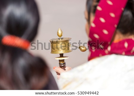 Woman with prayer mill in Gangtok India