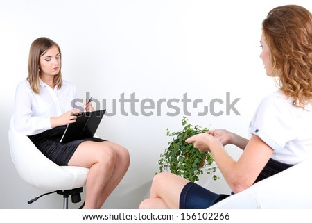 Woman with problem on reception for psychologist - stock photo