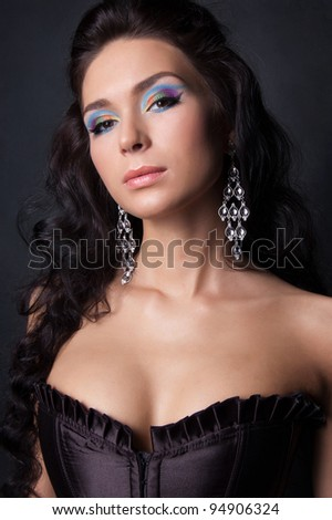 Woman with professional colourful fashion make-up - stock photo