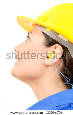 Woman with protective equipment and ear plugs - stock photo