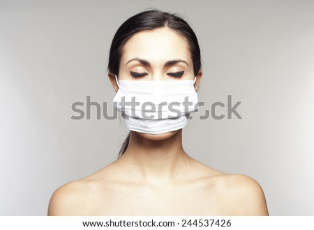 Woman with protective mask  over grey background - stock photo