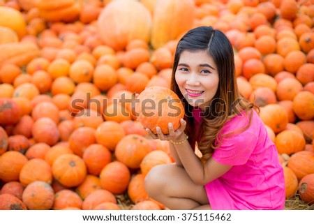 Woman with pumpkin.