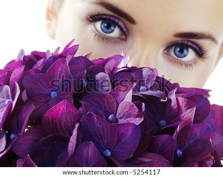 Woman with purple flowers. Focus on flowers.