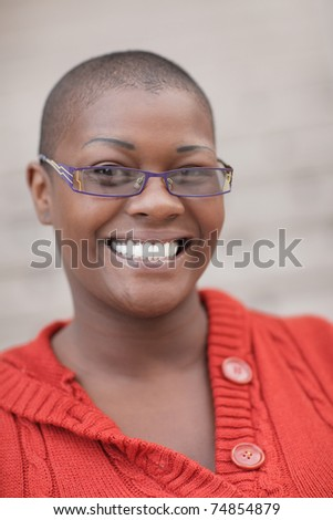 Woman with reading glasses smiling - stock photo