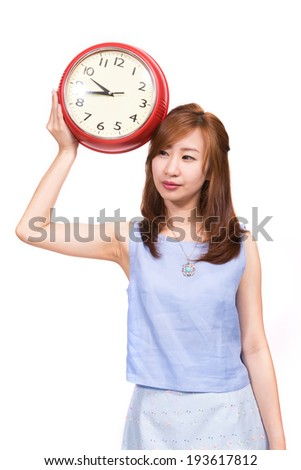 Woman with red alarm clock isolated on white