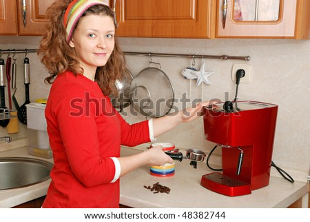 woman with red coffee machine - stock photo