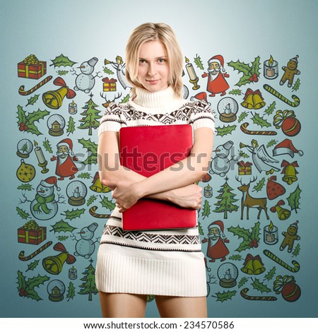 Woman with red laptop waiting for Christmas - stock photo