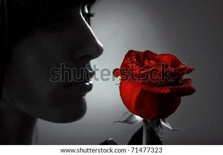 Woman with red rose, macro, black white and red rose - stock photo