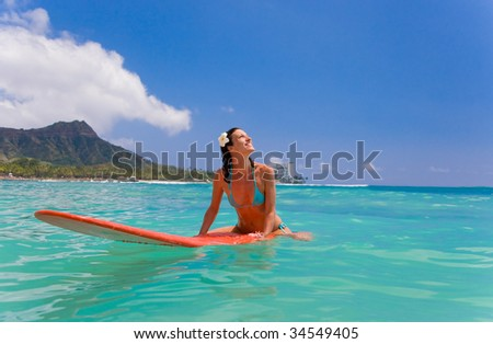 woman with red surfboard in waikiki, diamond head, oahu - stock photo