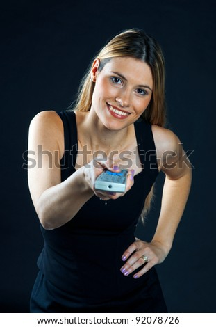 woman with remote control making expression - stock photo