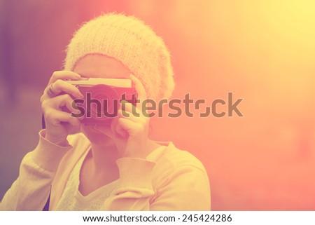 Woman with retro camera - stock photo