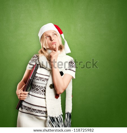 Woman with Santa's hat waiting for Christmas, with laptop in her hands - stock photo