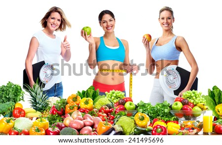 Woman with scales fruits and vegetables background - stock photo