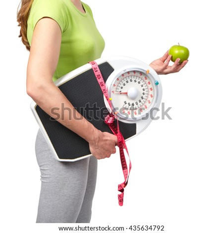 Woman with scales. Isolated white background. Diet, healthy lifestyle. - stock photo