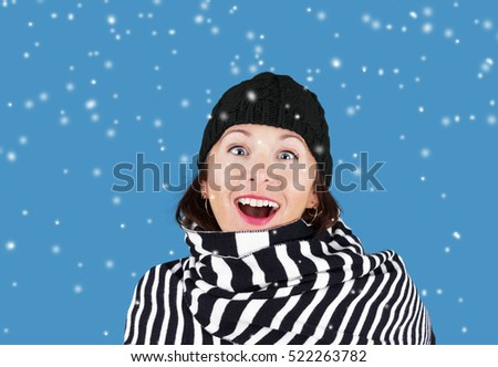 Woman with scarf and winter hat with snow