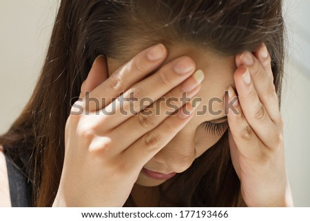 woman with serious headache, migraine, stress, hangover, mental problem - stock photo
