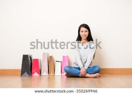 Woman with shopping bag in home - stock photo