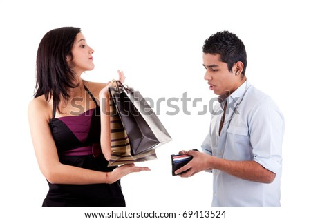 woman with shopping bags and man opened his wallet, isolated on a white background. Studio shot. - stock photo