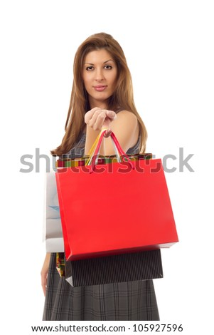Woman with shopping bags - Beautiful brunette woman holding several shopping bags on her finger