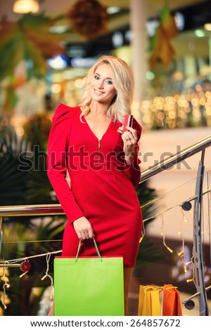 Woman with Shopping Bags in Shopping Mall. Shopper. Shopping Center. Sales. - stock photo