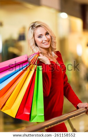 Woman with Shopping Bags in Shopping Mall. Shopping Center. Sales. - stock photo