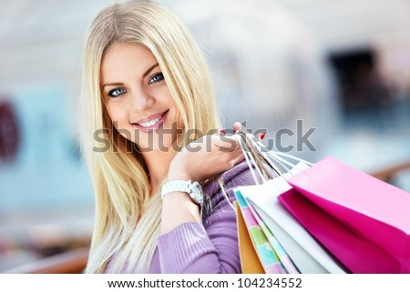 Woman with shopping bags in store - stock photo
