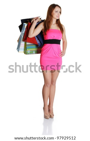 Woman with shopping bags isolated on white background - stock photo